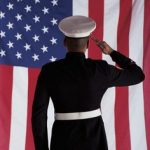solider saluting flag